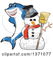 Clipart Of A Shark School Mascot Character With A Christmas Snowman Royalty Free Vector Illustration