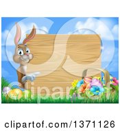 Clipart Of A Brown Easter Bunny Rabbit With Eggs And A Basket Pointing Around A Blank Wood Sign Against Sky Royalty Free Vector Illustration by AtStockIllustration