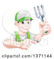Clipart Of A Young Brunette White Male Gardener In Green Holding A Garden Fork And Pointing Over A Sign Royalty Free Vector Illustration