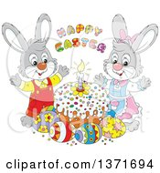 Clipart Of A Happy Easter Greeting Above Cartoon Male And Female Bunny Rabbits A Cake And Eggs Royalty Free Vector Illustration