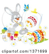 Clipart Of A Happy Gray Bunny Rabbit Painting A Canvas And Easter Egg A Butterfly Flying Above Royalty Free Vector Illustration