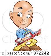 Young Bald Guy Playing A Keyboard Instrument