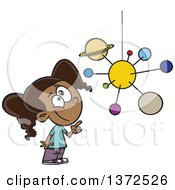 Cartoon Clipart Of A Smart Black School Girl Looking Up And Pointing At A Solar System Mobile Royalty Free Vector Illustration by toonaday