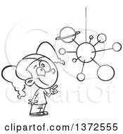 Cartoon Clipart Of A Black And White Smart School Girl Looking Up And Pointing At A Solar System Mobile Royalty Free Vector Illustration