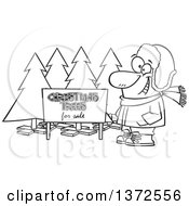 Cartoon Clipart Of A Black And White Happy Man Selling Christmas Trees At A Lot Royalty Free Vector Illustration by toonaday