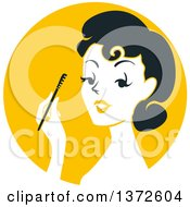 Clipart Of A Retro Woman Applying Mascara Over A Yellow Circle Royalty Free Vector Illustration by BNP Design Studio