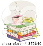 Hot Floral Coffee Cup On A Stack Of Books