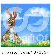 Clipart Of A Happy Brown Easter Bunny With A Basket Of Eggs And Flowers In The Grass Against A Blue Sky Royalty Free Vector Illustration