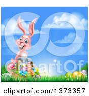 Clipart Of A Happy Pink Easter Bunny With A Basket Of Eggs And Flowers In The Grass Against A Blue Sky Royalty Free Vector Illustration
