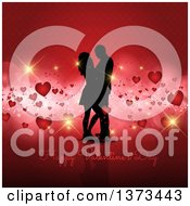 Happy Valentines Day Greeting Under A Silhouetted Couple On Red With Floating Hearts