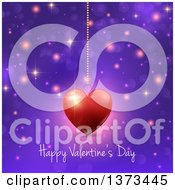 Happy Valentines Day Greeting Under A Suspended Heart Over Purple With Flares