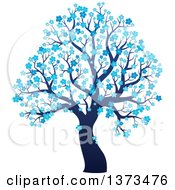 Clipart Of A Silhouetted Tree With Blue Winter Blossoms Royalty Free Vector Illustration
