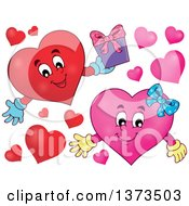 Clipart Of A Valentine Heart Character Holding A Gift And A Pink Female Heart Royalty Free Vector Illustration