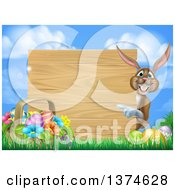 Clipart Of A Brown Bunny Rabbit With Eggs And An Easter Basket Pointing Around A Blank Wood Sign Against Sky Royalty Free Vector Illustration