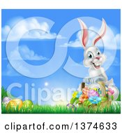 Clipart Of A Happy White Easter Bunny Rabbit With A Basket Of Eggs And Flowers In The Grass With Sky Text Space Royalty Free Vector Illustration
