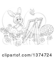 Clipart Of A Black And White Cute Easter Bunny Painting A Canvas And Eggs Royalty Free Vector Illustration