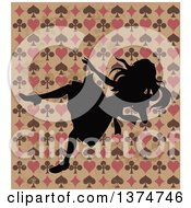 Alice In Wonderland Silhouetted And Falling Over A Grungy Design