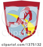 Clipart Of A Retro Ice Hockey Player In Action Inside A Shield Royalty Free Vector Illustration