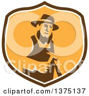 Clipart Of A Retro Amish Carpenter Man Holding A Hammer In A Brown White And Orange Shield Royalty Free Vector Illustration by patrimonio