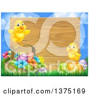 Poster, Art Print Of Cute Yellow Chicks On Easter Eggs And A Basket In The Grass Over A Blank Wood Sign And Sky