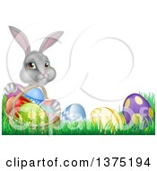 Clipart Of A Happy Gray Easter Bunny With A Basket Of Eggs And Flowers In The Grass With White Text Space Royalty Free Vector Illustration