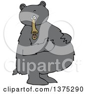 Cartoon Clipart Of A Black Bear Standing Upright And Resting His Paws On His Full Belly Royalty Free Vector Illustration
