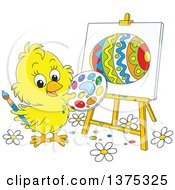 Cute Yellow Easter Chick Painting An Egg On A Canvas