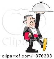 Formal Male Waiter Serving A Steaming Dinner Cloche Platter