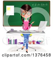 Brunette Caucasian Female Teacher Sitting At A Desk In Front Of A Chalk Board
