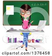 Brunette Caucasian Female Teacher Sitting At A Desk In Front Of A Chalk Board