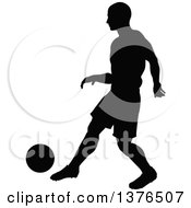 Clipart Of A Black Silhouetted Male Soccer Player Athlete In Action Royalty Free Vector Illustration