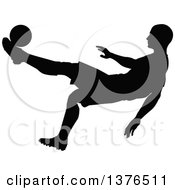 Clipart Of A Black Silhouetted Male Soccer Player Athlete In Action Royalty Free Vector Illustration by AtStockIllustration