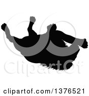 Clipart Of A Black Silhouetted Male Lion Rolling Around On His Back Royalty Free Vector Illustration