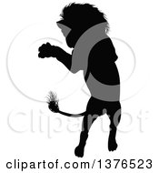 Clipart Of A Black Silhouetted Male Lion Rearing And Attacking Royalty Free Vector Illustration