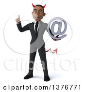 Clipart Of A 3d Young Black Devil Business Man Holding An Email Arobase At Symbol On A White Background Royalty Free Illustration