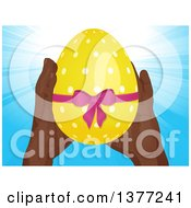 Pair Of Black Hands Holding Up A 3d Yellow Polka Dot Easter Egg With A Pink Bow