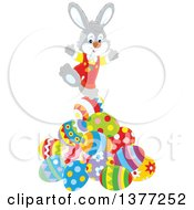 Clipart Of A Gray Easter Bunny Balancing On A Pile Of Decorated Eggs Royalty Free Vector Illustration