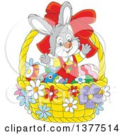 Clipart Of A Happy Gray Easter Bunny Rabbit Welcoming Inside A Basket With Eggs Royalty Free Vector Illustration