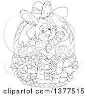 Clipart Of A Black And White Easter Bunny Rabbit Welcoming Inside A Basket With Eggs Royalty Free Vector Illustration