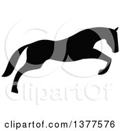 Clipart Of A Black Silhouetted Horse Leaping Royalty Free Vector Illustration