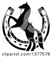 Clipart Of A Black And White Silhouetted Saddled Horse Rearing Over A Horseshoe Royalty Free Vector Illustration