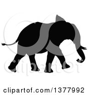 Clipart Of A Black Silhouetted Elephant Walking Royalty Free Vector Illustration
