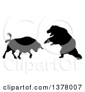 Black Silhouetted Stock Market Bull Fighting A Bear