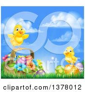 Clipart Of A Cute Yellow Chicks On Easter Eggs And A Basket In The Grass Over A Sunny Sky Royalty Free Vector Illustration