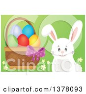 Clipart Of A Happy White Bunny Rabbit By A Basket Of Easter Eggs Royalty Free Vector Illustration