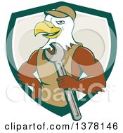 Clipart Of A Cartoon Bald Eagle Mechanic Man Holding A Wrench Emerging From A Green White And Tan Shield Royalty Free Vector Illustration