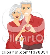 Happy White Senior Couple Wearing Matching Shirts And Forming A Heart With Their Hands