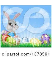 Clipart Of A Happy Gray Easter Bunny With A Basket Of Eggs And Flowers In The Grass Against Sky Royalty Free Vector Illustration