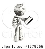 Clipart Of A Fully Bandaged Injury Victim Or Mummy Holding A Smart Phone Royalty Free Illustration