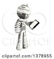 Fully Bandaged Injury Victim Or Mummy Holding A Smart Phone